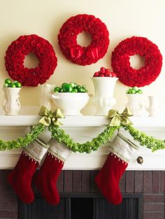 Chistmas carnations     Red carnation wreaths look elegant over this Christmas mantel. To make fresh wreaths, soak a florist's foam shape in water. Trim carnations to about 3 inches; and insert into forms; you'll need about 50 carnations for a 12-inch diameter wreath. You can also craft pretty—and long-lasting—wreaths with artificial flowers.  Accent with containers of shiny red and green ornaments along your mantel.