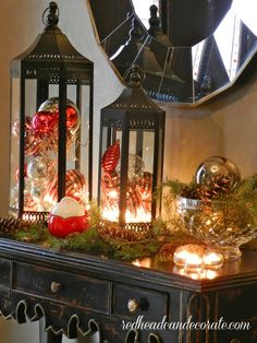 Love the lights in the lanterns with ornaments...Maybe on my new hall table