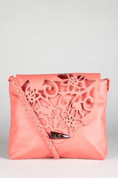 beautiful little bag, like the cutout design, maybe with another color under the cutout?