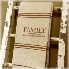 """Cotton towel with embroidered verse and stamped horizontal lines.  Phrase reads, """"Family A blessing to treasure, better than wealth of any measure."""""""