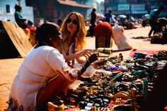 Lauren Conrad shopping with a local artisan in Nepal