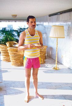 Freddie Mercury... could he be more adorable?!  and those chairs too.