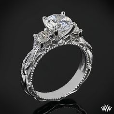 This 3 Stone Engagement Ring is from the Verragio Venetian Collection. It features 0.45ctw (F/G VS) round brilliant cut diamond melee to enhance a round, oval or square diamond center of your choice. The width tapers from 4mm at the top down to 3.3mm at the bottom. Select your diamond from our extensive online diamond inventory. Please allow 4 weeks for completion. If you have any questions regarding this item then please contact one of our friendly diamond and jewelry consultants at…