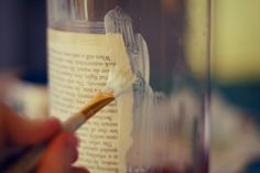 bookpage jars look so charming with a candle in them at night. They're easy to make, and I can almost guarantee you already have everything to make them. Need: old bookpages, drawings, maps, woodgrain contact paper, anything paper! mod-podge & a brush jars (make sure you can fit a candle inside them first) or hurricane glass