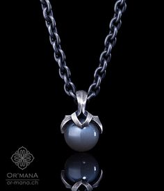 Silver mattened and blackened Tahiti Pearl pendant with laether necklace. Handmade designer jewelry by Or-Mana.ch Goldsmith in Zurich Switzerland.