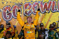 At-track photos: Saturday, Kansas:   Sunday, May 8, 2016  -   Kyle Busch celebrates his first Sprint Cup Series win at Kansas Speedway in Victory Lane.   -   Photo Credit: Photo by Brian Lawdermilk/Getty Images