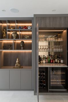 After many years of family life, a clean and contemporary renewal was required at this wearied home. Built In Bar Cabinet, Modern Bar Cabinet, Home Bar Cabinet, Home Wet Bar, Bars For Home, Home Cocktail Bar, Kitchen Bar Design, Living Room Bar, Home Bar Decor