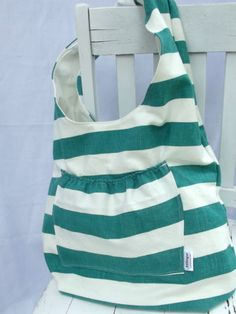 Great tutorial on how to make a simple, reversible sling bag. Seems like an easy enough project with lots of color and pattern possibilities. I like the pocket on the inside and outside.