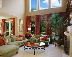 Tall window treatment. Curtains do not drown windows & bring the window up making it look taller.