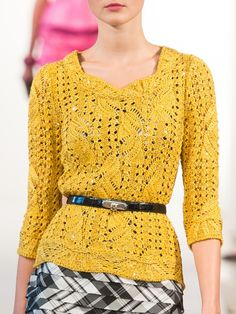 Oscar de la Renta- cute, simple ensemble with thin belt, patterned skirt, and sweater/knit top