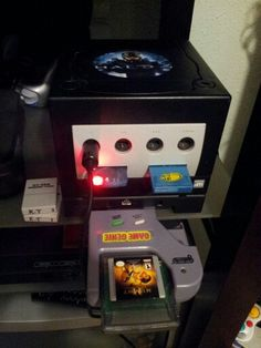 My Nintendo GameCube with Game Genie and mod chip with component cables