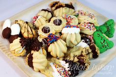 Authentic professional bakery style Italian Butter Spritz Cookies filled with jam, chocolate or ganache & dipped in nuts & sprinkles. Your cookie exchange..