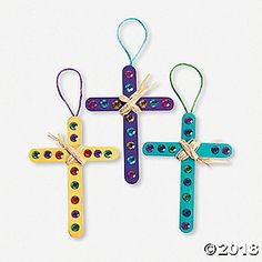 Raffia Cross Craft Kit. Wrap the raffia for a beautiful looking cross! Includes self-adhesive plastic pieces and nylon string for hanging. 6 © OTC