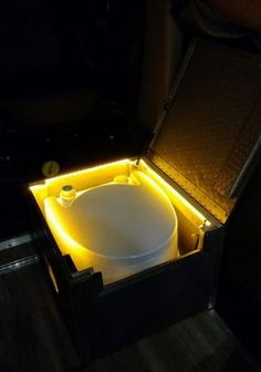 When building our van, we knew there would be no extra room for a built-in toilet, but we knew we would want one. Our toilet solution was sort of an afterthought, but the great thing about that is you are forced to get creative. Sprinter Van Conversion, Camper Van Conversion Diy, Orange Led Lights, Hidden Toilet, Truck Bed Camper, Vw Camper, Vw T4, Vw Vanagon, Van Interior