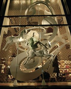 MesVitrinesNYC: White Louis Vuitton, we have made horses for many Window displays, and ideas for several.  Carousel Workshop