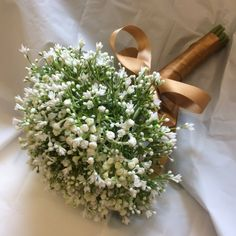 An artificial wedding bouquet of white Gypsophilia flowers