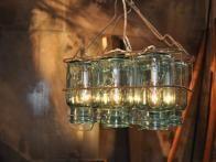 Vintage Mason jars were transformed into a very cool,  industrial-style chandelier on HGTV's  Flea Market Flip .
