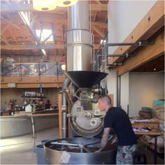 A coffee roaster in operation. Sight Glass, SoMa, San Francisco.