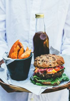 A happy meal - veggie burger, sweet potato fries and kombucha