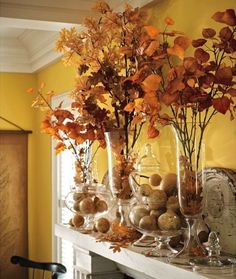 One striking piece of art or mirrors, art, foliage and accessories for  layering the mantel!