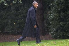 Image detail for -After canceling his appearance at a morning campaign rally in Orlando, Fla., President Barack Obama walks toward the White House in a driving rain after...