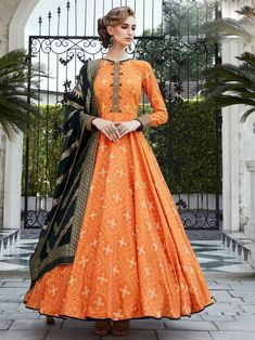 Enticing orange digital printed gown online at best shopping price. Shop this latest gown style for diwali celebration. This alluring style set comprises a silk gown with matching jacquard dupatta.