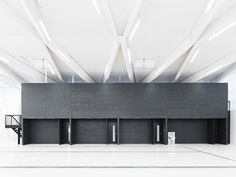 The new laboratory for the Institute of Hydro Sciences in Neubiberg, Munich, responds to its diverse environment with a clear and well-proportioned volumetric shape, a soothing horizontally structured façade and subtle materials.  The placid and clean-...
