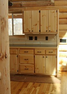 Cabinets (made of MDF) scored to look like tongue-and-groove wooden ...
