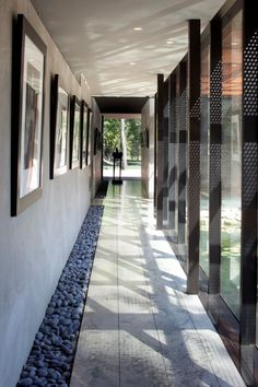 Heavy Metal House by Hufft Projects love the stone/pebble walk way accented with artwork