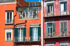 traditional italian red houses with green windows