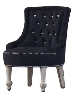 San Graziella's Slipper Chair from A Noir Home: Dark Furnishings on Gilt