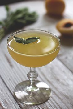 Golden Plum & Sage Cocktail: pisco, sparkling wine, honey syrup, lemon juice, pinch of salt, peach bitters, golden plum, sage leaves | Honestly YUM