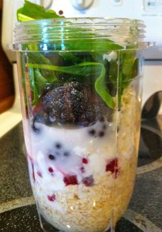 Breakfast Smoothie - 1/4-1/2 cup of oats, about 1/4-1/2 cup of greek yogurt, a handful of frozen fruit, and about 1/8 a cup of spinach...blend and add water to get to the preferred consistency. NutriBullet!!!