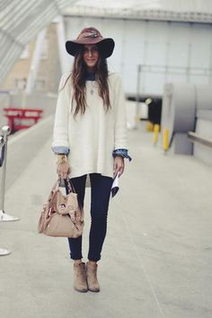 fall outfit: cream oversized sweater layered over a chambray shirt, skinny jeans, worn with suede booties
