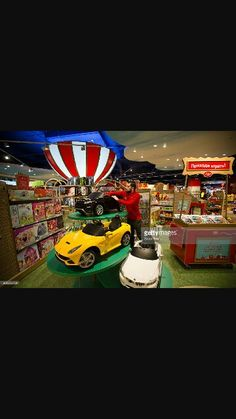 """Haha just loved the big cars.  Also got idea of having a large version of a """"toy shop"""" as a counter"""