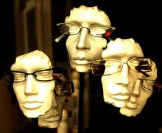 An opticians window in Shoreham. Masks by grahambrown1965, via Flickr