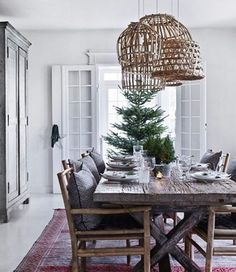 Let the Christmas tree be the center piece and place it close to the dining table. That will bring even more excitement to the evening. Home of Tine Kjeldsen, tinekhome.com