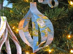 Christmas Around The World. Upcycle maps for Christmas gifts to missionary and travelers. Christmas Tree Festival, Ward Christmas Party, Christmas Tree Themes, Xmas Tree, Christmas Ideas, Around The World Theme, Holidays Around The World, Joy To The World, Christmas Travel