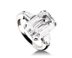 GRIFFE RING  Griffe solitaire ring in platinum with emerald cut diamond and two side diamonds. Available from 1 ct.  A classic setting that allows the beauty and the pureness of the solitaire diamond to assert itself Ref. AN851183