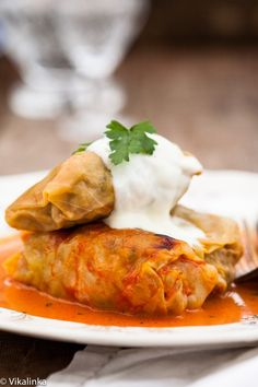 Russian Cabbage Rolls stuffed with extra lean beef, rice and veggies and baked in a creamy tomato sauce. Comfort food at its best. #SochiOlympics