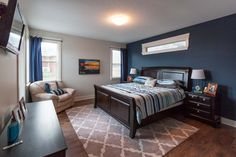 master bedroom painted in grey owl with hudson bay blue feature wall