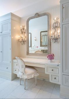 The frilly, glamorous interiors are fit for a Hollywood starlet, Jennifer Lawrence.  This make up area is divine!  Love the sconces and the bead board and the calacatta marble.