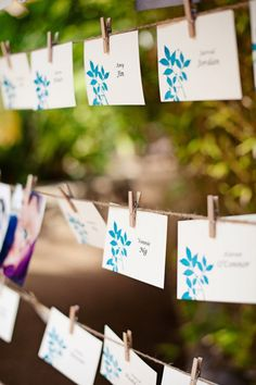 String twine in between two trees/props with mad libs or some other wedding game