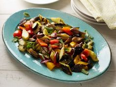 Grilled Ratatouille Total: 33min., Prep: 25min., Cook: 8min., Serves 4-6 INGREDIENTS: 2 zucchini, quartered lengthwise; 2 yellow squash, cut into quarters lengthwise; 2 Japanese eggplant, halved lengthwise; 2 red & 2 yellow bell peppers, stemmed/seeded/quartered; 2 red onions, quartered; 1pt cherry tomatoes; 1/2c + 2T olive oil; salt & freshly grind pepper; 4 cloves garlic, finely chopped; fresh: 2T oregano & 4T parsley, both diced