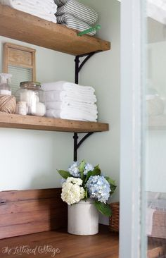 Laundry Room | Rustic Wood Shelves | Old Door Countertop.  Wall color:  Water Slide, Dutch Boy. September 2014. Lovely.