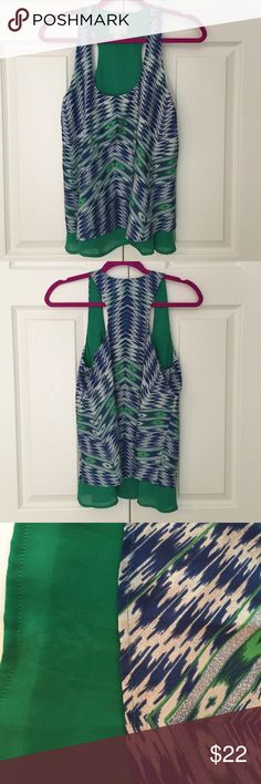 "🆕 Anthropologie Aztec Print Layered Swing Top super fun Aztec print layered swing top from Maeve for Anthripologie. 100% poly. size small. bust flat is 17"", length is 25"". excellent condition but please see 3rd photo for faint stain on green underlay near front hem. Anthropologie Tops"