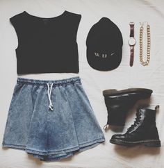 Grunge outfit idea nº9: Black cap, black T, Black Doc Martens, denim print shorts, brown watch & thick banded gold chain necklace - http://ninjacosmico.com/23-awesome-grunge-outfits/
