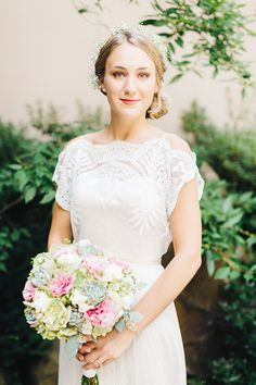Bride in BHLDN gown -- pretty bouquet with lots of succulents! See more here: http://www.StyleMePretty.com/2014/05/26/romantic-garden-wedding-at-the-rockford-art-museum/ #SMP - Photography: RyanTimmPhotography.com