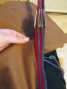 Ett vikingaliv: weaving and fastening a tablet woven band at the same time!