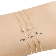 14k gold tiny diamond bracelet diamond floating by EnveroJewelry